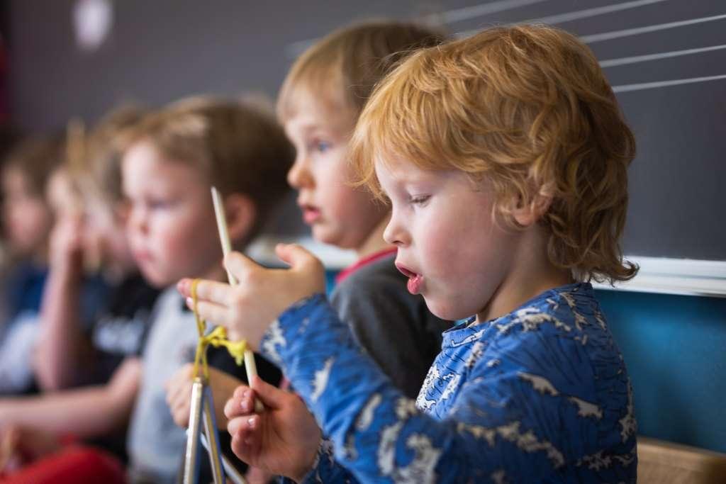 Children in music playschool