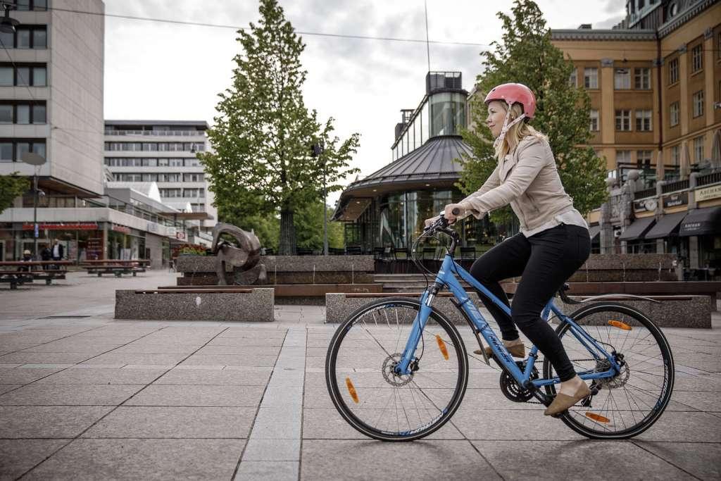 Girl bikes on the street