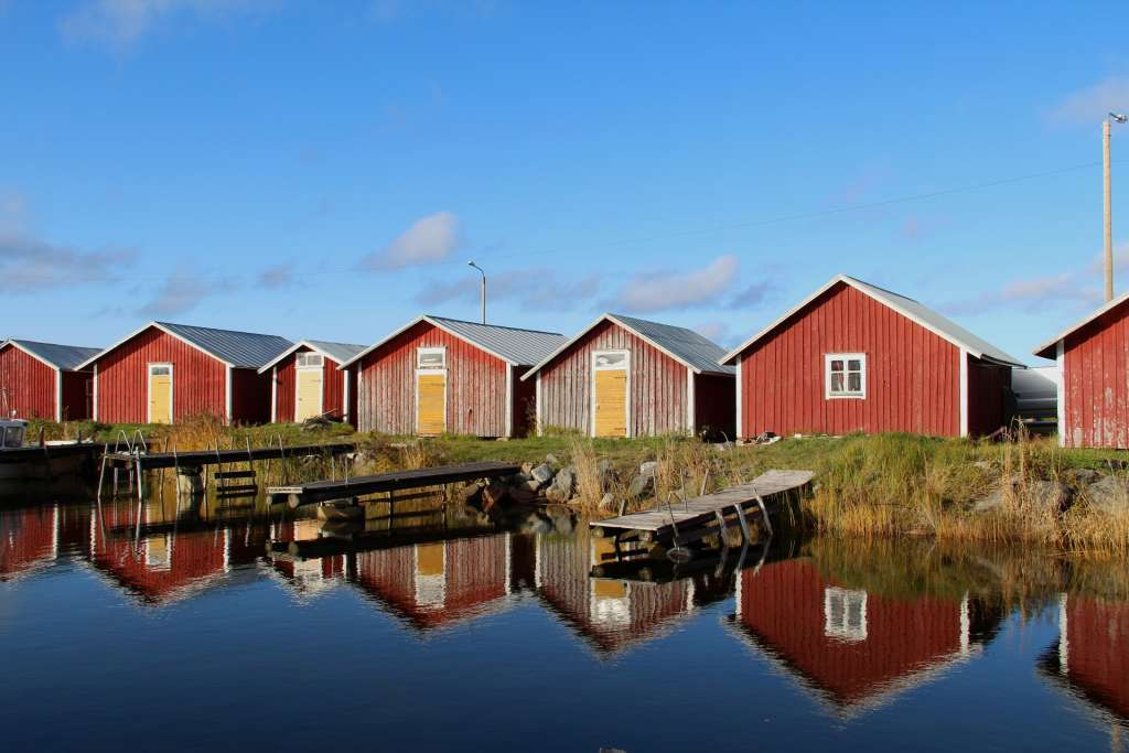 Boat houses by the water